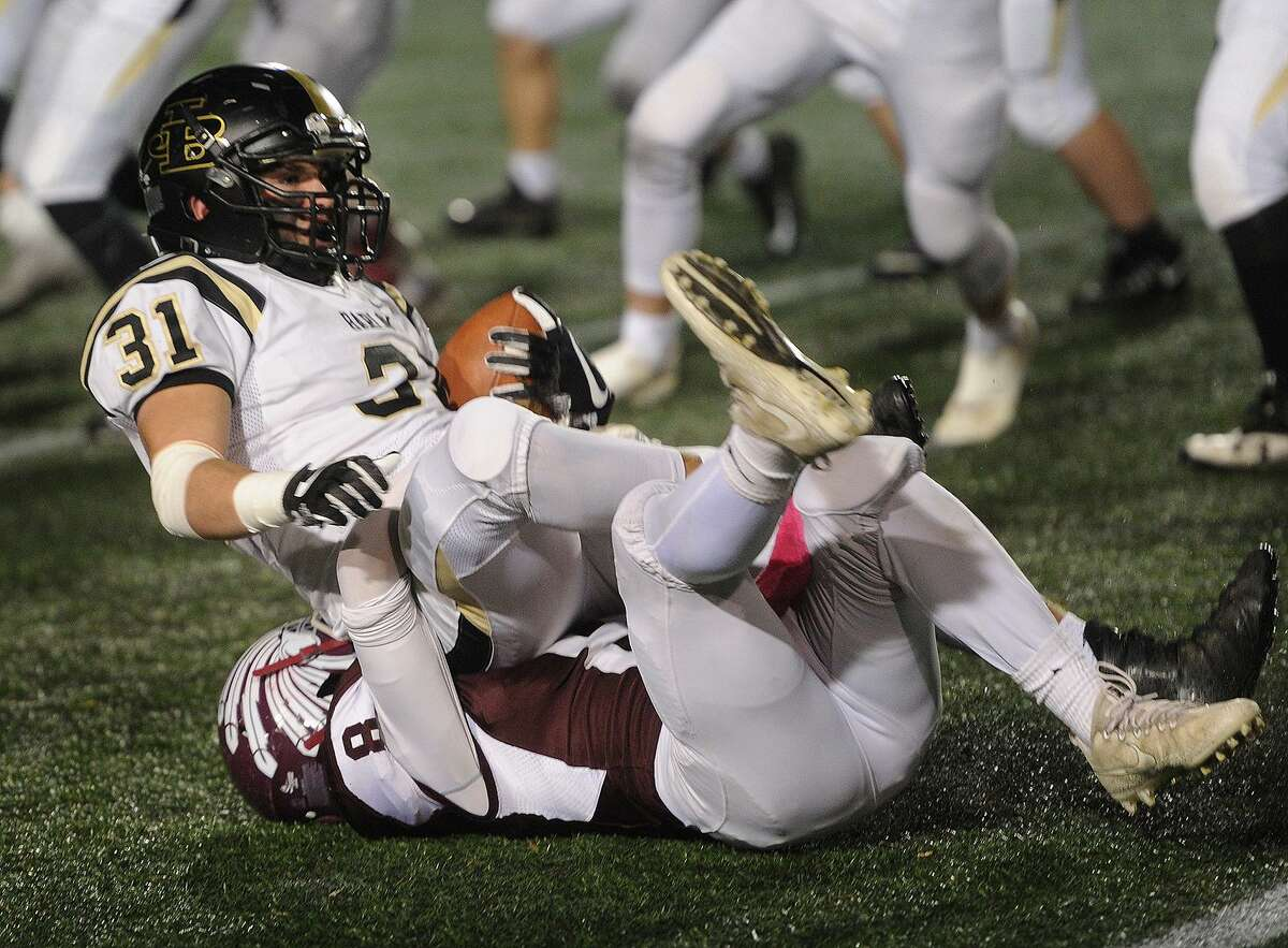 Joel Barlow's Cal Peterson is tackled by Killingly defender Zack Burgess in the first half of the CIAC Class M State Championship game at Veterans Stadium in New Britain, Conn. on Monday, December 11, 2017.