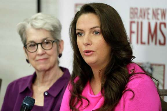 Jessica Leeds, left, and Samantha Holvey attend a news conference, Monday, Dec. 11, 2017, in New York to discuss their accusations of sexual misconduct against Donald Trump. The women, who first shared their stories before the November 2016 election, were holding the news conference to call for a congressional investigation into Trump's alleged behavior.  (AP Photo/Mark Lennihan)