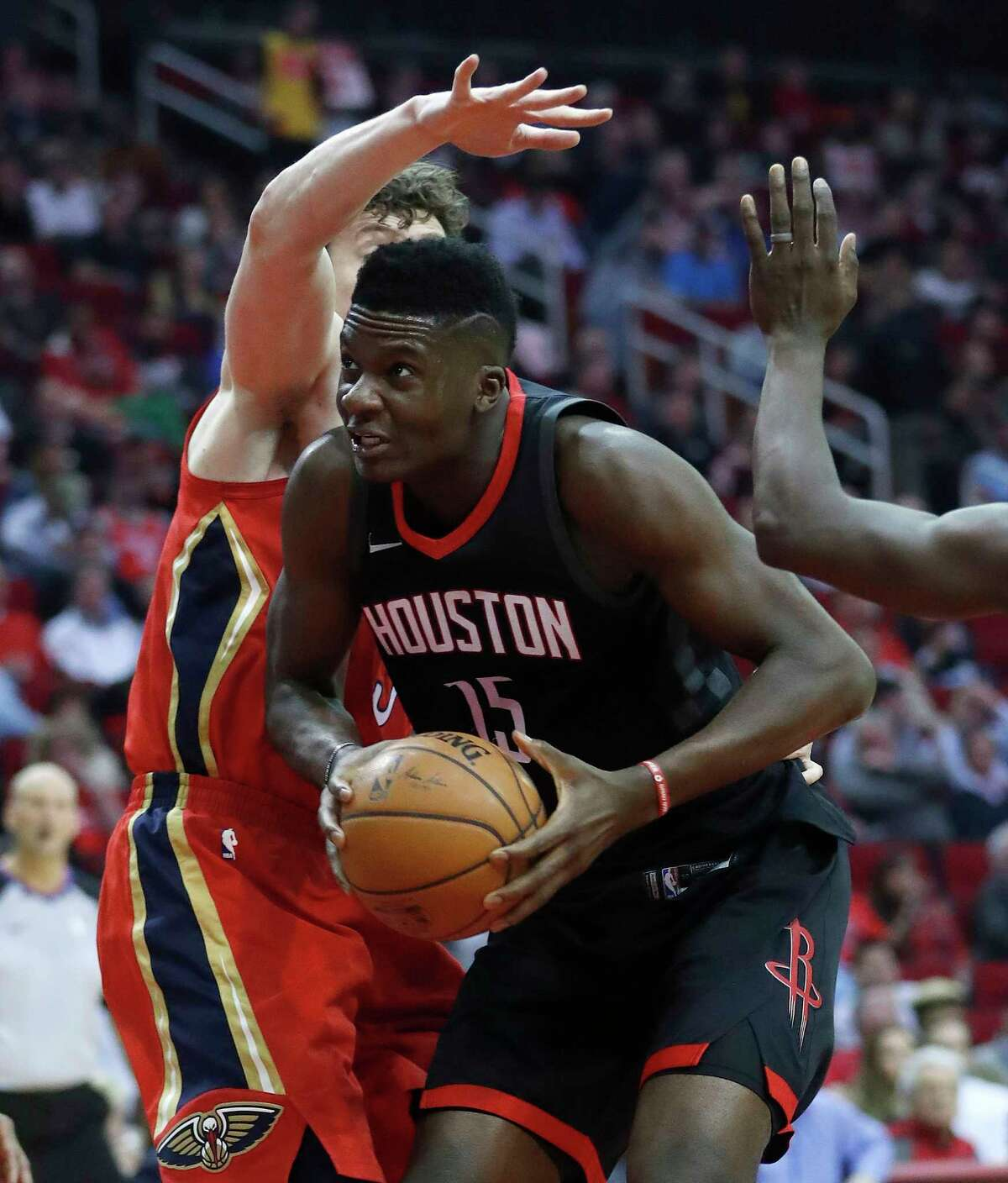 Houston Rockets center Clint Capela (15) dives under the basket during the first half of an NBA game at Toyota Center, Monday, Dec. 11, 2017, in Houston.