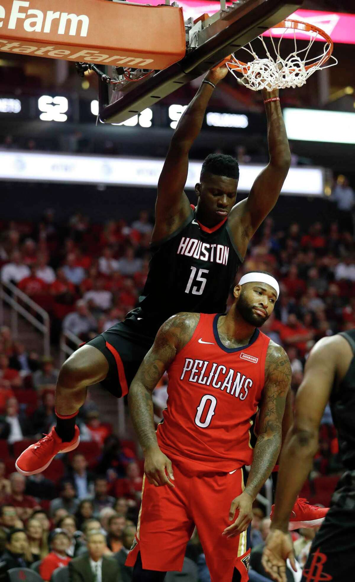 Houston Rockets center Clint Capela (15) dunks the ball over New Orleans Pelicans center DeMarcus Cousins (0) during the first half of an NBA game at Toyota Center, Monday, Dec. 11, 2017, in Houston.