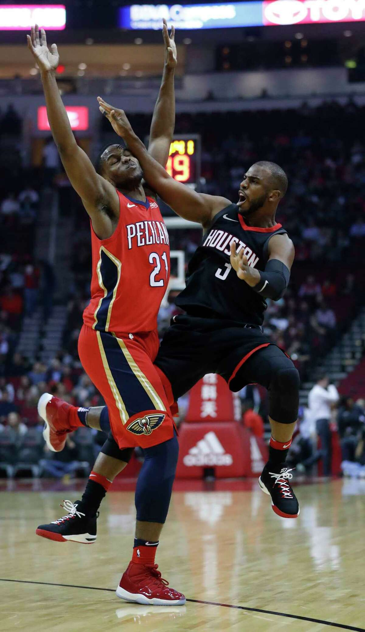 Houston Rockets guard Chris Paul (3) tries to shoot a three-pointer over New Orleans Pelicans forward Darius Miller (21) during the first half of an NBA game at Toyota Center, Monday, Dec. 11, 2017, in Houston.