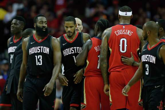Houston Rockets forward Trevor Ariza (1) and New Orleans Pelicans center DeMarcus Cousins (0) are separated after a brief scuffle during the first half of an NBA game at Toyota Center, Monday, Dec. 11, 2017, in Houston.