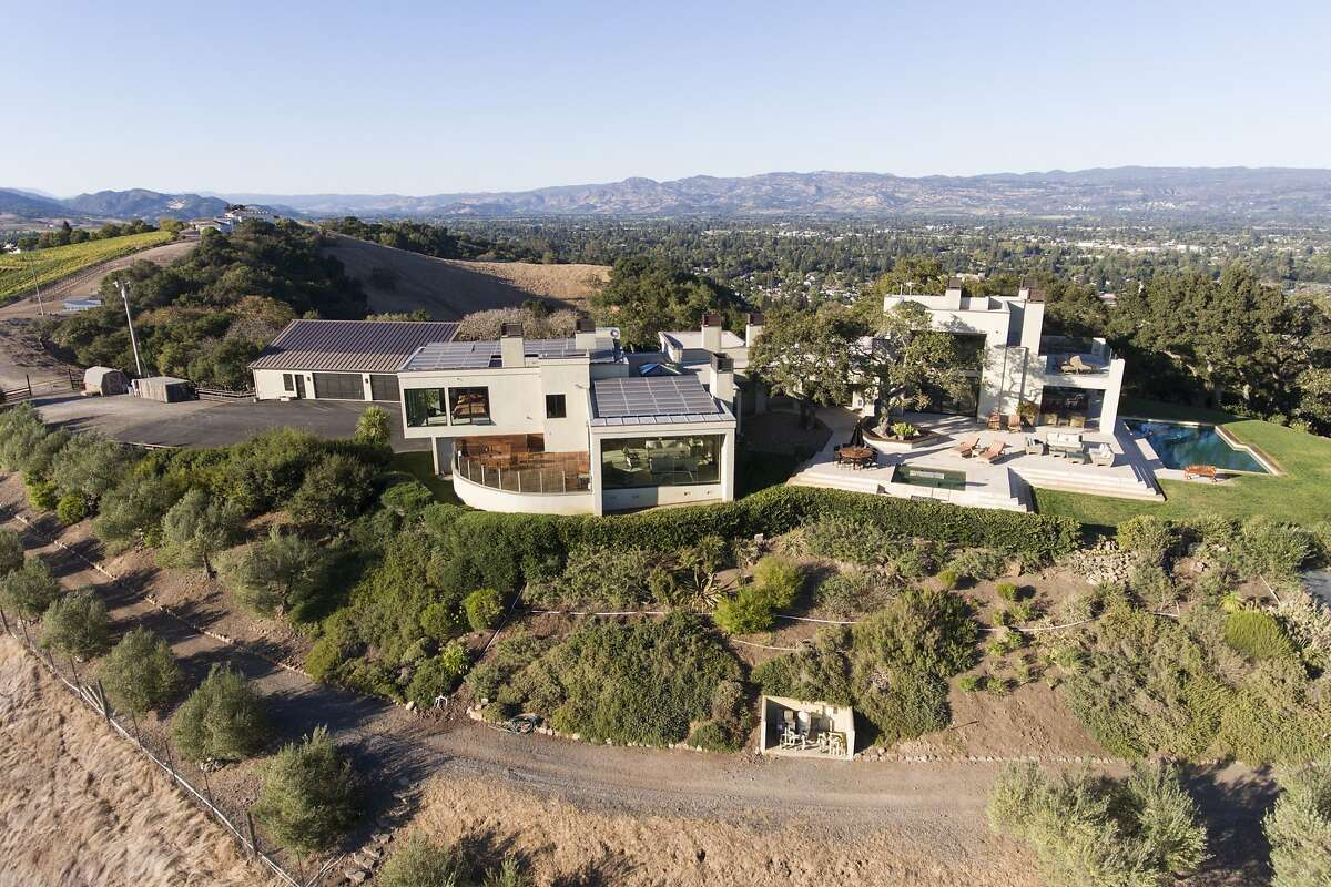 The contemporary home offers more than 7,000 square feet of living space on a private hilltop.�