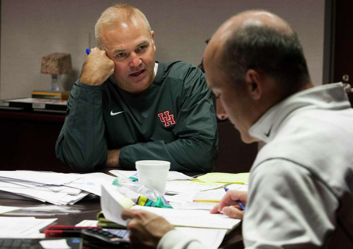 Chris Pezman, left, knows UH well, having played football there and also serving as an assistant athletic director with then-coach Tony Levine.