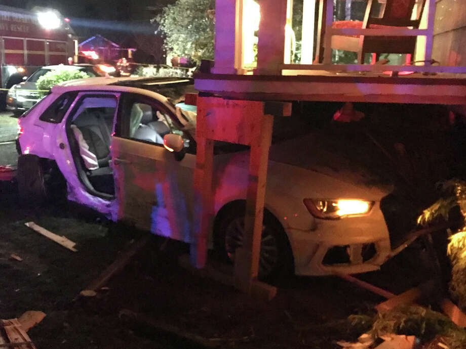 Seattle Fire Department personnel and police responded Monday evening after a car rammed a University District home. Photo: Seattle Fire Department