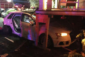 Seattle Fire Department personnel and police responded Monday evening after a car rammed a University District home.