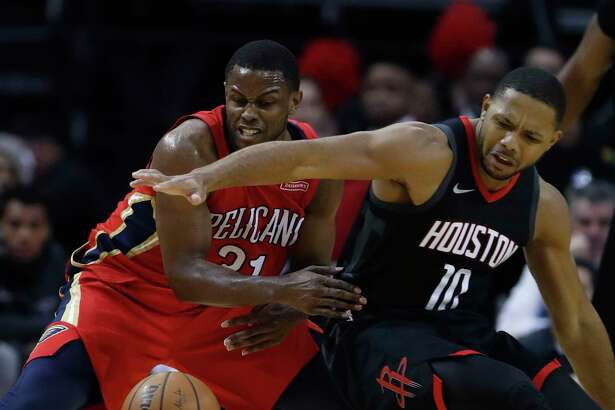 Houston Rockets guard Eric Gordon (10) battles for a loose ball against New Orleans Pelicans forward Darius Miller (21) during the second half of an NBA game at Toyota Center, Monday, Dec. 11, 2017, in Houston. Rockets won 130-123.