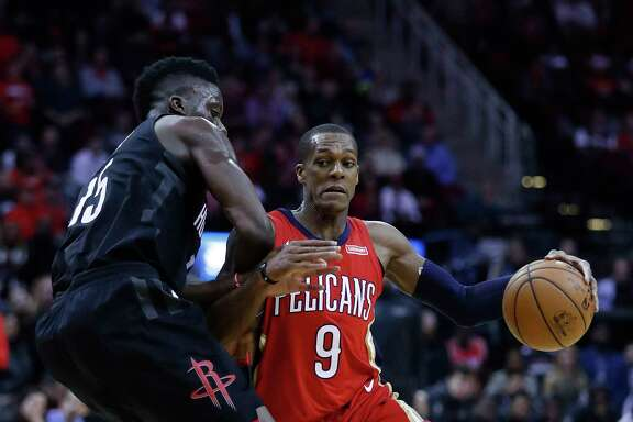 New Orleans Pelicans guard Rajon Rondo (9) tries to get past Houston Rockets center Clint Capela (15) during the second half of an NBA game at Toyota Center, Monday, Dec. 11, 2017, in Houston.
