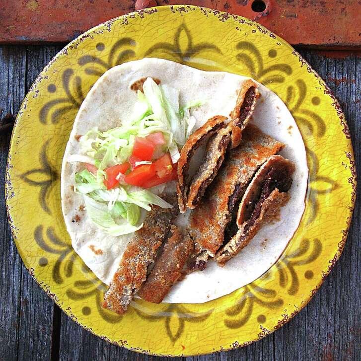 Beef milanesa taco on a handmade flour tortilla from Rancho Grande.