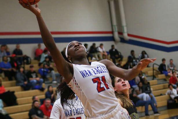 Oak Ridgeé•s Alecia Whyte (21) shoots during the varsity girls basketball game against Montgomery on Tuesday, Jan. 10, 2017, at Oak Ridge High School. (Michael Minasi / Chronicle)