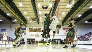 Vermont's Drew Urquhart drives down the lane against Siena in their nonconference game on Monday, Dec. 11, 2017. (Brian Jenkins / Vermont Athletics)