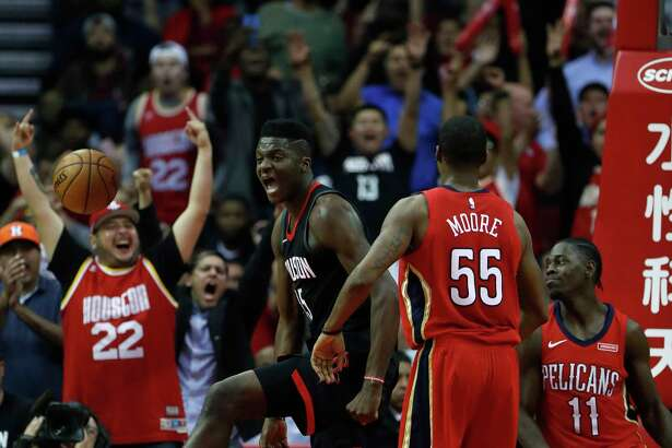 Center Clint Capela celebrates after scoring in the midst of the Rockets' comeback during the second half Monday night. Capela had 28 points to lead the Rockets and outscore his celebrated counterpart DeMarcus Cousins by four.