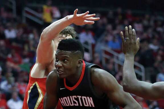 Houston Rockets center Clint Capela (15) dives under the basket during the first half of an NBA game at Toyota Center, Monday, Dec. 11, 2017, in Houston.  ( Karen Warren / Houston Chronicle )