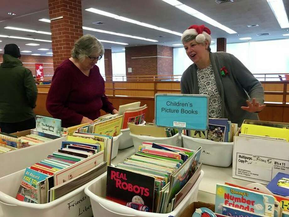 The Friends of the Library hosted a Holiday Bargain Book Sale Saturday, Dec. 9 in the mezzanine area of the Grace A. Dow Memorial Library to fund restoration of the children's area in the library's basement. (Kate Carlson/kcarlson@mdn.net)