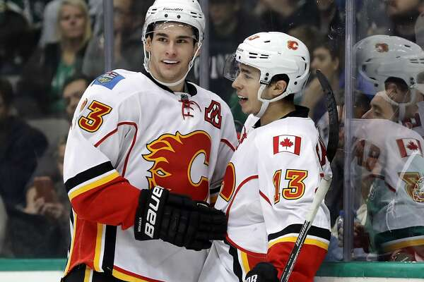 DALLAS, TX - DECEMBER 06:  Sean Monahan #23 and Johnny Gaudreau #13 of the Calgary Flames celebrate a goal against the Dallas Stars in the second period at American Airlines Center on December 6, 2016 in Dallas, Texas.  (Photo by Ronald Martinez/Getty Images)