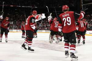 GLENDALE, AZ - NOVEMBER 04:  Mario Kempe #29, Nick Cousins #25, Alex Goligoski #33 and teammates of the Arizona Coyotes salute the fans after a win against the Carolina Hurricanes at Gila River Arena on November 4, 2017 in Glendale, Arizona.  (Photo by Norm Hall/NHLI via Getty Images)