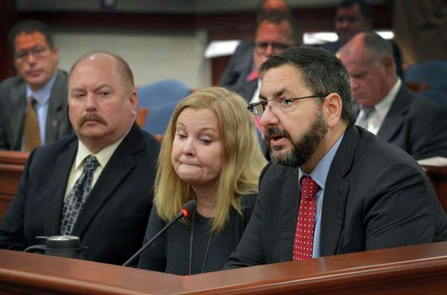 The parents of Marine Lance Cpl. Ryan Burgess --Jon Burgess and Kim Burgess-- join state Sen. Jim Stamas, R-Midland, to testify in support of Stamas' legislation to permanently honor Burgess by designating a portion of U.S. 10 in Sanford as the 'Marine Lance Corporal Ryan Burgess Memorial Highway.' (Photo provided)