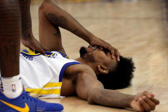 Nick Young (6) on the court after getting shaken up trying to retrieve a rebound during the second half as the Golden State Warriors played the Portland Trail Blazers at Oracle Arena in Oakland, Calif., on Monday, December 11, 2017.