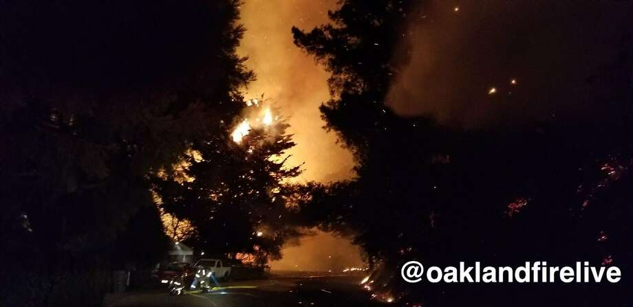 An image from the Oakland Fire Department shows the view at Snake Road and Armour Drive during Monday night's fire. Photo: Courtesy Oakland Fire Department / @OaklandFireLive