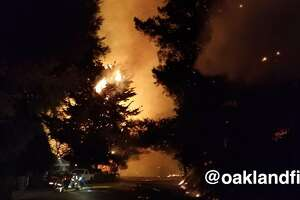 An image from the Oakland Fire Department shows the view at Snake Road and Armour Drive during Monday night's fire.