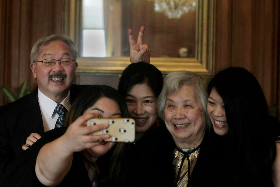 Mayor Ed Lee (left) clowns around during a photo with his daughter Tania Lee, wife Anita Lee, mother Pansy Lee and daughter Brianna Lee at City Hall in 2015. Photo: Lea Suzuki, The Chronicle