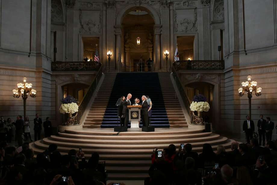 Gov. Jerry Brown (left) administers the Mayoral Oath of Office to Mayor Ed Lee in the City Hall rotunda in 2015. Photo: Lea Suzuki, The Chronicle