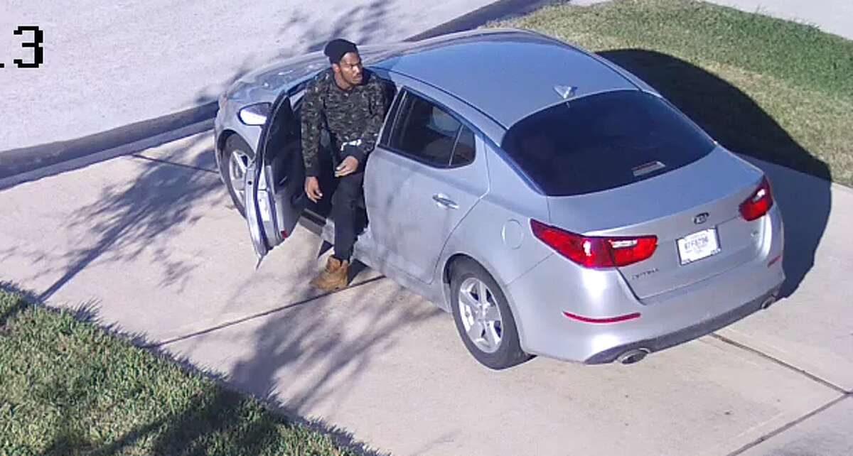 A package thief was caught on surveillance video tripping over himself while stealing a box from the front of a Houston home Dec. 8.