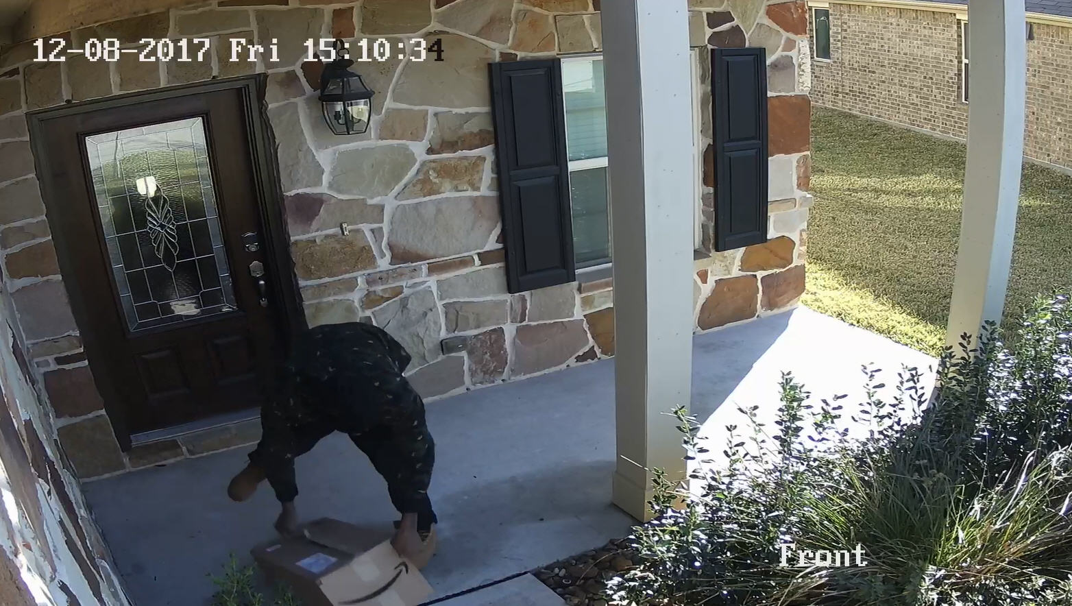 Houston thief caught on video struggling to steal heavy package from front of home