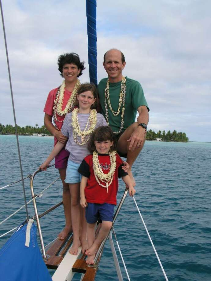"Next to their boath, ""the Estrela,"" the Hopkins family wears their new shell necklaces from Fiji after crossing the Pacific in August 2004. Photo: Contributed Photo / Westport News"