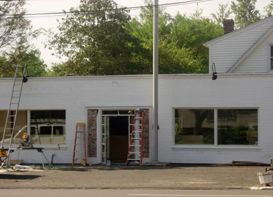 The Milton Design building is under construction, and will be opening on July 21. Photo: Contributed Photo / Westport News