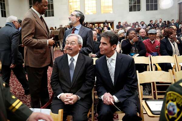 Mayor Ed Lee and senator Mark Leno chat  before sheriff Vicki Hennessy is sworn into office at city hall in San Francisco, California, on Friday,  January 8, 2015.
