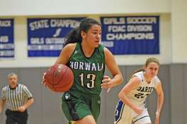 Norwalk's Ashley Wilson drives to the hoop against Darien on Monday. Wave 61-52. Wilson led the Bears with 21 points.