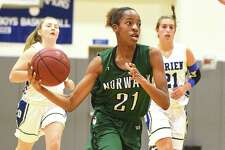 Norwalk freshman Jakara Murray drives to the hoop during Monday's season-opening victory over Darien.