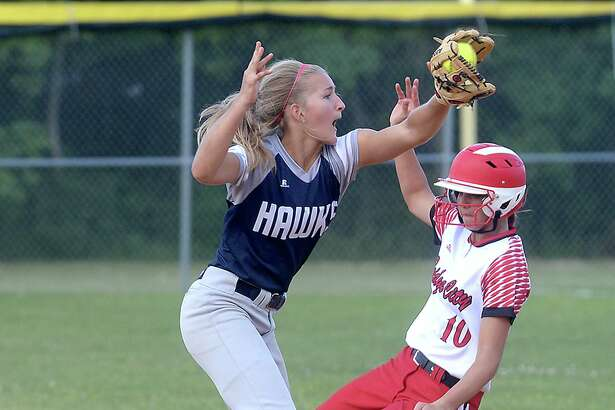 Hardin - Jefferson's Caroline Spacek tries for the out as Bridge City's Kassidy Wilbur slides into second ahead of the throw during their first game of the regional quarterfinal playoffs at Port Arthur Memorial Wednesday. Photo taken Wednesday, May 10, 2017 Kim Brent/The Enterprise