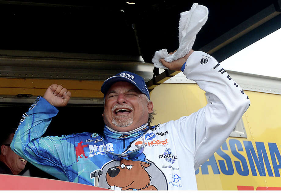 Orange's pro angler Carl Svebek celebrates after winning the tournament trophy on the final day of the Bassmaster Bass Pro Shop Open in Orange Saturday. Both the pro and co-angler trophies were won by Orange natives, to the applause of the crowd that filled the stage area for the results. Photo taken Saturday, June 17, 2017 Kim Brent/The Enterprise Photo: Kim Brent / BEN