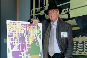 "11/20/12: Pete Brown with a map of Washington Street.  After very seriously running in 2009, architect and former city council member Peter Brown has transformed himself into Houston's leading utopian. His group, Better Houston, promotes urban planning and walkability. In on-line videos, Brown turns himself into a Stephen Colbert-like character, ""Pedestrian Pete,"" who walks around the city with guests, chatting about the good, the bad and the ugly."