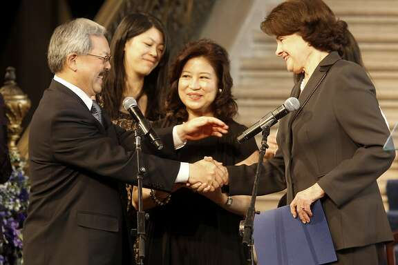 Mayor Ed Lee embraced Senator Dianne Feinstein after the oath of office was administered.  Lee's wife Anita (center) and daughters looked on. San Francisco Mayor Ed Lee was inaugurated at a ceremony at San Francisco City Hall Sunday January 8, 2012.