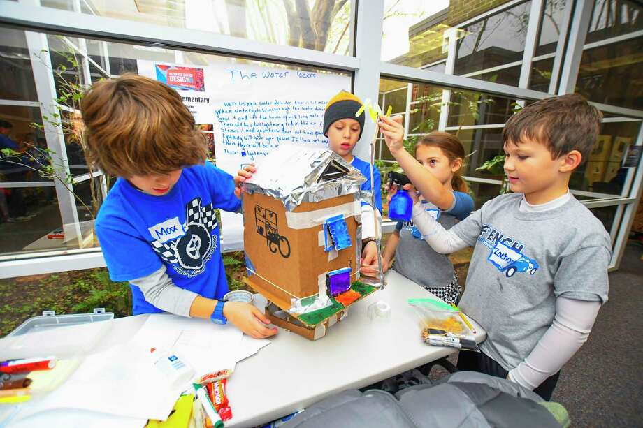 French Elementary school students Max Tullos, Indie Gross, Claire Shine and Zachary Seay all thought of building a home that can automatically be elevated 3 to 6 feet to avoid the flood water. The home also would have solar panels and a windmill for electrical power.  More than 275 teams from around Klein ISD, which included more than 1,500 students from all grade levels, gathered at the Klein ISD Teaching Learning Center and the Multipurpose Center to create and work together on flood-prevention projects.      The event came about through Klein's partnership with JASON Learning. The Klein Water Warriors event has more than 1,000 students signed up to work in teams to work on projects to prevent flooding. Photo: Tony Gaines/ HCN, Photographer