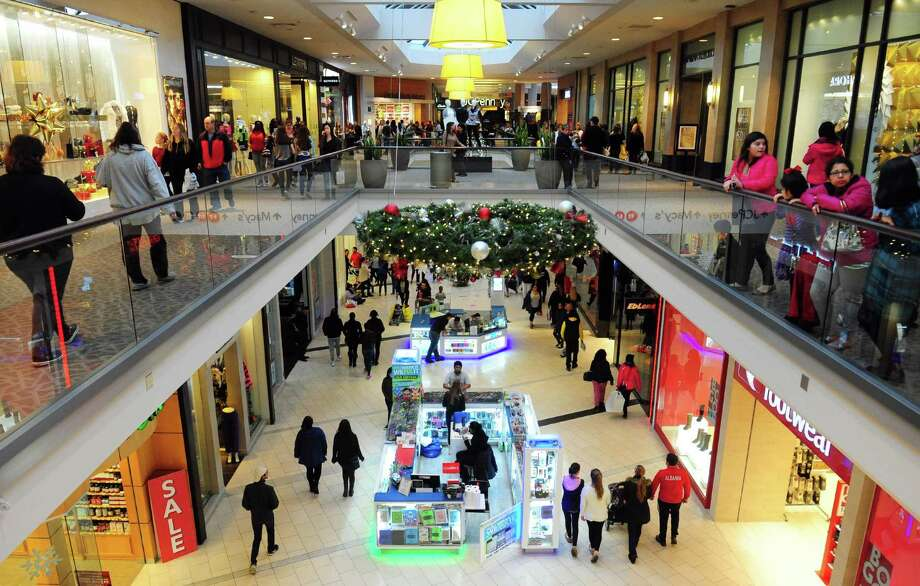 Shoppers look for Black Friday deals at the Westfield Trumbull Mall in Trumbull last year. Westfield Corp., which owns the Trumbull mall along with more than 30 others around the country, will be sold in a $15.7 billion deal. Photo: Christian Abraham / File Photo / Connecticut Post