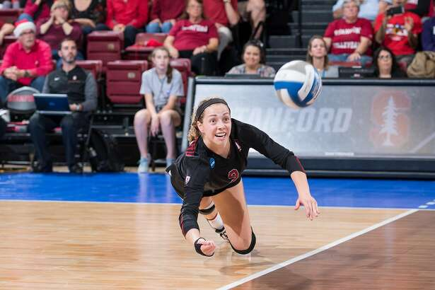 Libero Morgan Hentz makes a dig for the Stanford volleyball team.