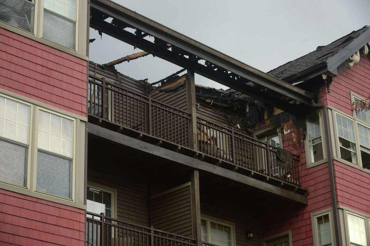 Stonewood Condominiums at 100 Richards Ave. Tuesday, December 12, 2017, following a fire there Monday night in Norwalk, Conn. Residents were concerned about whether their pets would make it out safely and where they would stay following the devastating blaze.