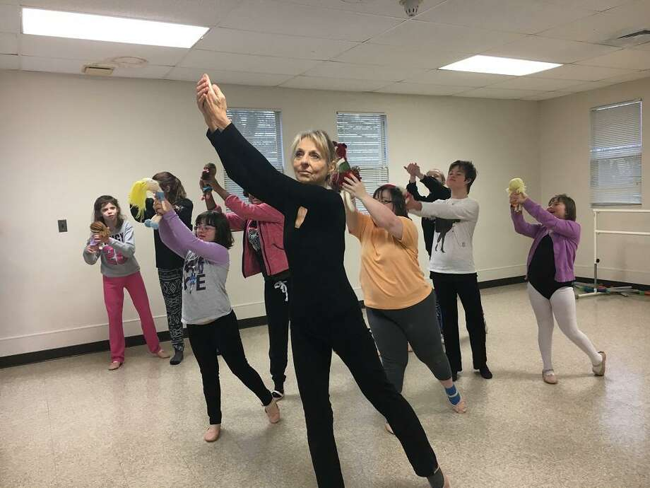 Deb Marchese leads practice of the Little Wing Adaptive Ballet Company, a Milford Recreation Department program. The dancers of varying ages and abilities will perform their own version of the 'Nutcracker' Friday at Parson's complex in Milford. Tickets are $5 and will be sold at the door. Contributed Photo. Photo: Pam McLoughlin / Contributed Photo