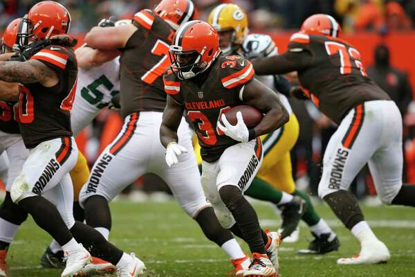 Cleveland Browns running back Isaiah Crowell (34) runs the ball against the Green Bay Packers in the second half of an NFL football game, Sunday, Dec. 10, 2017, in Cleveland. (AP Photo/Ron Schwane)