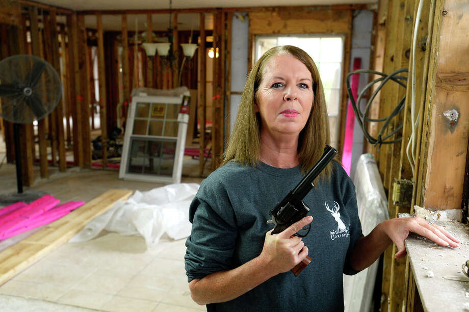 Barbara Emmons worries about thieves in her section of Bevil Oaks since Tropical Storm Harvey flooded the town's residents. Without insulation in the home, she hears every noise nearby, and she keeps her .357 Magnum revolver close. Photo taken Thursday 12/7/17 Ryan Pelham/The Enterprise Photo: Ryan Pelham / ©2017 The Beaumont Enterprise/Ryan Pelham