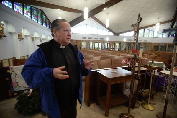 The Rev Jim McClintock talks Friday about the storm damage St. Mary Catholic Parish in Fannett received from Tropical Storm Harvey.    Photo taken Friday, December 08, 2017 Guiseppe Barranco/The Enterprise
