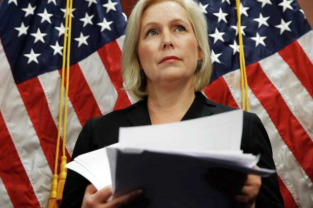 """Sen. Kirsten Gillibrand, D-N.Y., attends a news conference, Tuesday, Dec. 12, 2017, on Capitol Hill in Washington. Gillibrand says President Donald Trump's latest tweet about her was a """"sexist smear"""" aimed at silencing her voice."""