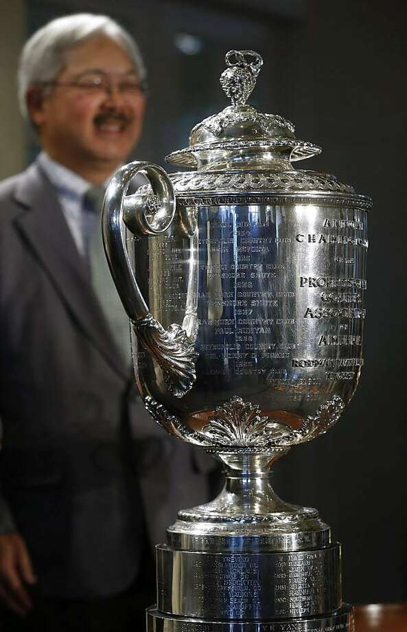 Mayor Ed Lee stands behind the Wanamaker Trophy during an event at the Olympic Club in San Francisco, Calif. on Wednesday, Nov. 8, 2017 to announce that the club will host the 2028 PGA Championship and the Ryder Cup in 2032. Photo: Paul Chinn, The Chronicle
