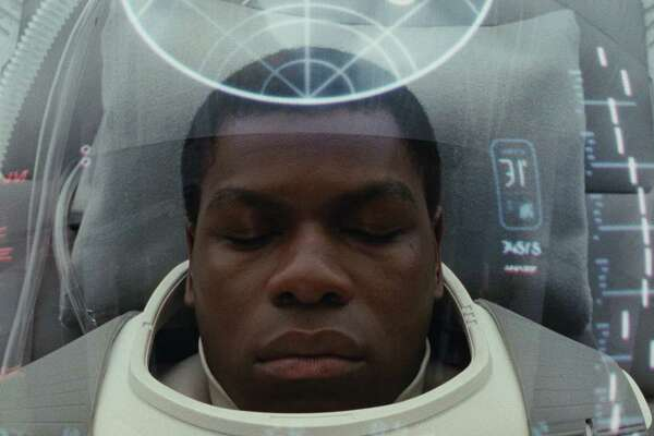 """This image released by Lucasfilm shows John Boyega as Finn in """"Star Wars: The Last Jedi,"""" in theaters on Dec. 15. (Lucasfilm via AP)"""