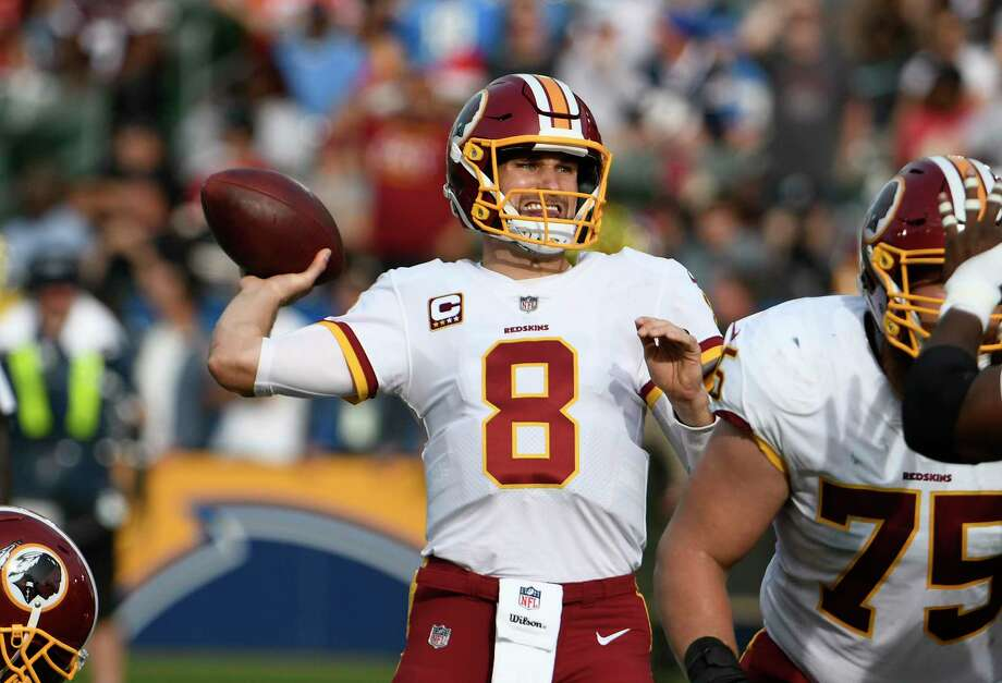 Washington Redskins quarterback Kirk Cousins (8) plays during an NFL football game against the Los Angeles Chargers on Sunday, Dec. 10, 2017, in Carson, Calif. (AP Photo/Denis Poroy) Photo: Denis Poroy, Associated Press / FR59680 AP
