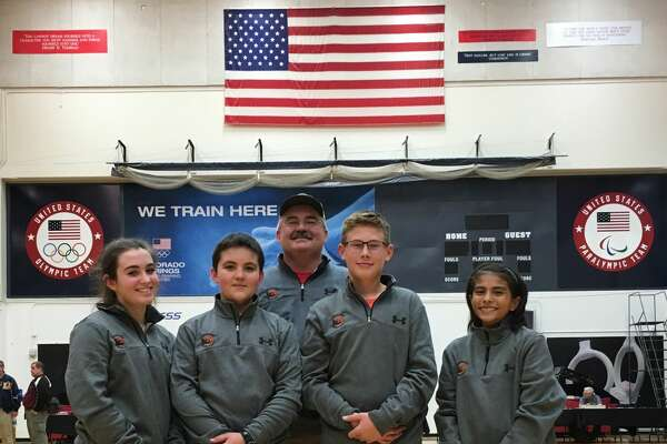 Four members of the Permian Basin Young Guns and Midland 4-H Rifle & Pistol Club rifle team Brooke Willhite, from left, Cash Willhite, Emmitt Seabaugh and LeeAnna Crudgington competed in the Winter Air Gun Championships last weekend at the Olympic Training Center in Colorado Springs, Colo. With them is their coach, Kevin Willhite.